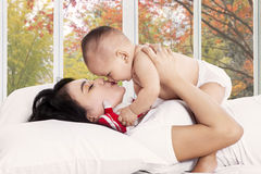 Happy mother kiss her baby girl Stock Photo