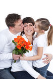 Happy mother kissed by her family Stock Photos