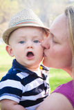 Happy Mother Kissing Cute Baby Boy Stock Image