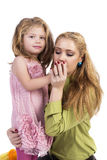 Happy mother kissing her liitle daughter hand Royalty Free Stock Images