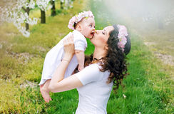 Happy mother kissing her little princess Royalty Free Stock Image