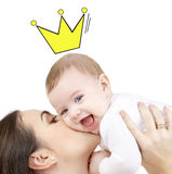 Happy mother kissing and holding baby Royalty Free Stock Photos