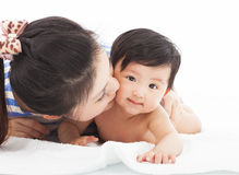 Happy mother kissing  smiling child baby Royalty Free Stock Images