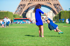 Happy mother and little adorable girl have fun in Paris near Eiffel Tower Stock Photography