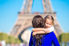Happy mother and little adorable girl have fun in Paris near Eiffel Tower Stock Photo