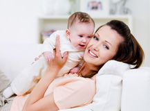 Happy mother with little baby Stock Photos