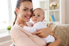 Happy mother with little baby boy at home stock image
