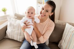 Happy mother with little baby boy at home stock images
