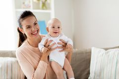 Happy mother with little baby boy at home royalty free stock photo