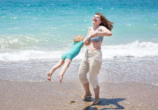 Happy mother and little baby son having fun at beach vacation Royalty Free Stock Photo