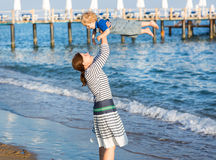 Happy mother and little baby son having fun at beach vacation Royalty Free Stock Photography