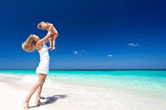 Happy mother and little child on beach Royalty Free Stock Photography