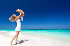 Happy mother and little child on beach Stock Image