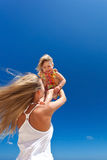Happy mother and little child on beach Stock Photos