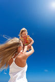 Happy mother and little child on beach Stock Photography
