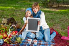 Happy mother with little daughter in autumn park Royalty Free Stock Photo