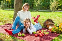 Happy mother with little daughter in autumn park Royalty Free Stock Photos