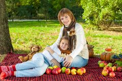 Happy mother with little daughter in autumn park Stock Photography