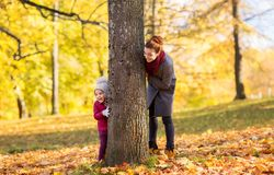 Happy mother and little daughter at autumn park Stock Photography