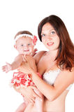 Happy mother and little daughter in her arms Stock Photo