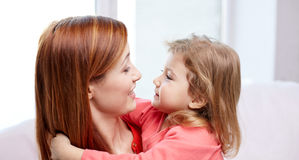 Happy mother and little daughter hugging at home Royalty Free Stock Photos