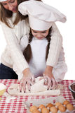 Happy mother with little daughter joyful cooking Royalty Free Stock Images