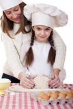 Happy mother with little daughter joyful cooking Stock Image