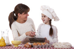 Happy mother with little daughter joyful cooking Stock Photo