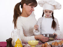 Happy mother with little daughter joyful cooking Royalty Free Stock Photography