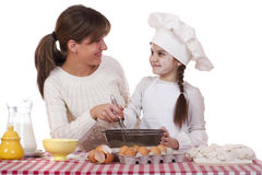 Happy mother with little daughter joyful cooking Stock Images