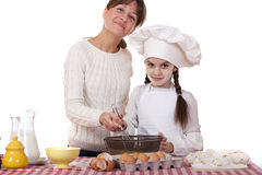 Happy mother with little daughter joyful cooking Stock Photography