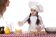 Happy mother with little daughter joyful cooking Royalty Free Stock Photo