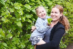 Happy mother and little daughter laughing together Stock Photo