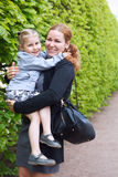 Happy mother and little daughter laughing together Royalty Free Stock Photography