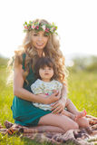Happy mother with little daughter on the meadow Royalty Free Stock Images