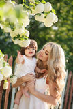 Happy mother with little daughter on the meadow Royalty Free Stock Photos