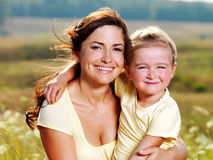 Happy mother and little daughter on nature Royalty Free Stock Photo