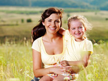 Happy mother and little daughter on nature Royalty Free Stock Image