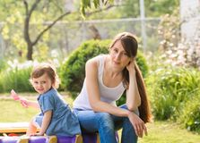 Happy mother and little daughter on nature Stock Photos