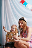 Happy mother and little daughter play sailors in studio Royalty Free Stock Images