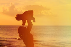 Happy mother and little daughter play at sunset Royalty Free Stock Photography