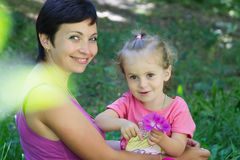 Happy mother and little daughter playing Stock Images