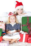 Happy mother with little daughter in santa hat Royalty Free Stock Photography