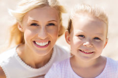 Happy mother and little daughter on summer beach. Family, travel, vacation, adoption and people concept - happy mother and little daughter on summer beach Royalty Free Stock Images