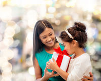 Happy mother and little girl with gift box Royalty Free Stock Images