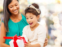 Happy mother and little girl with gift box Stock Images