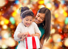 Happy mother and little girl with gift box Royalty Free Stock Photos