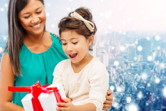 Happy mother and little girl with gift box Royalty Free Stock Photo
