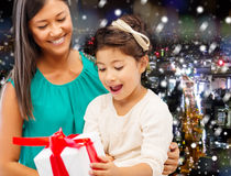 Happy mother and little girl with gift box Stock Photo