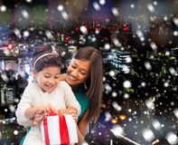 Happy mother and little girl with gift box Stock Photos